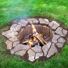 "Cool fire pit.    FINALLY found the original pin for this!      Only cost $42 to make!!!    Dig a 2ft deep hole four feet around. Purchase 25 4x4x12 pavers and 12 flagstone pavers. We bought ours from Menards. We also put two bags of 3/4"" river rock in the bottom. It's so easy, we did it in just a little over an hour."