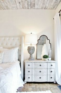 all white on white farmhouse rustic styled bedroom, love the old wood ceiling treatment