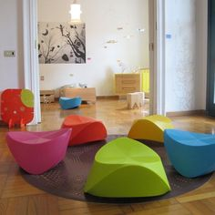 Colorful, modern rocking chairs for the playroom. So cool!