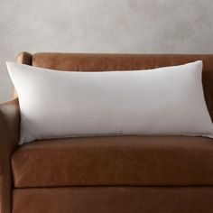 """Shop 36""""x16"""" linon white pillow.   Our favorite pile-on pillow is ready to layer and lounge in 100% natural linen.  Solid white front flips to same color back.  Perfect year-round as the neutral in your pillow palette."""