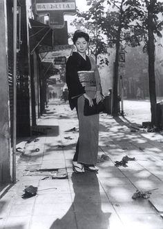 "Keiko Yashiro (Hideko Takamine): ""In the evenings, the moment when I climb the stairs is the worst. But when I reach the top of the stairs, the curtain to another world opens..."" -- from When a Woman Ascends the Stairs (1960) directed by Mikio Naruse"