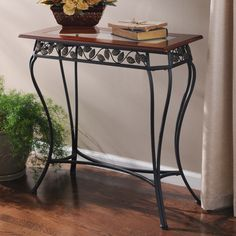 With a glass top framed in walnut-finished wood, this table is oh so charming. #kirklands #glam+chic #accenttable