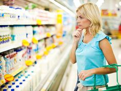"""When you're at the grocery store and two options are staring you down—one that says """"reduced fat"""" and one that's unapologetically full-fat—choosing the less fattening option is a no-brainer, right? Not so fast! """"Just because a product is labeled 'fat-free' or 'lowfat' doesn't mean it's healthier or even lower in calories,"""" says Jared Koch, a nutritionist in New York and the founder of Clean Plates. """"In fact, most lowfat or fat-free foods will have sugar and chemicals to make up for the loss…"""