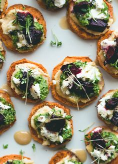 Sweet Potato Rounds with Hummus, Arugula Basil Pesto, Goat Cheese, Roasted Beets, Sprouts, and a drizzle of honey