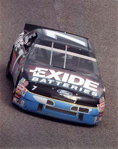History of the No. 7 in NASCAR through the years  -  April 14, 2017:    GEOFFREY BODINE, 4  -    After the death of Alan Kulwicki in 1993, Bodine purchased the late driver's equipment and formed his own team. In 1994, Bodine won at Pocono, Michigan and Dover, and two years later, he would scored his final victory in the No. 7 on the Watkins Glen road course.