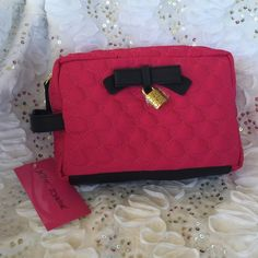 Betsy Johnson makeup bag Gorgeous Betsy Johnson bag with side handle lock in Fuchsia and Black. 9 inches long X 6 inches depth X 3 inches wide Betsey Johnson Bags Travel Bags