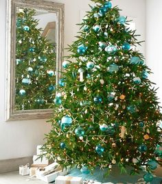 Blue Christmas Ornaments | Aqua, Turquoise & other Ocean Hues.... Featured on Completely Coastal: http://www.completely-coastal.com/2016/12/blue-christmas-ornaments-coastal.html