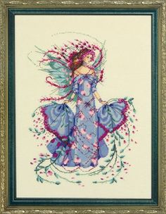 Mirabilia October Opal Fairy - Cross Stitch Pattern. Model stitched on 32 Ct. Ivory Linen, DMC floss, and Mill Hill beads. Also required, but not listed above,