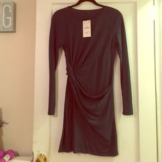 NWT Zara green dress with side knot. Size M NWT Zara dress in dark forest green with side knot detail. Size large (on tag) Dress runs very small fits more like a small/medium rather than a large (not exaggerating) so any smalls or mediums this is better for you! Which is why I listed it under medium! Super cute no longer available in stores/online!! Zara Dresses Mini