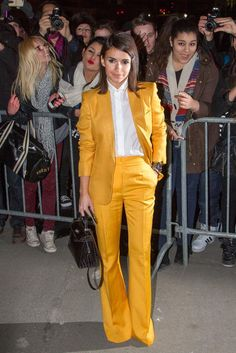 Buro 24/7 founder Miroslava Duma rocks a flared pantsuit in this summer's It color, a decidedly awesome shade of not-too-bright yellow