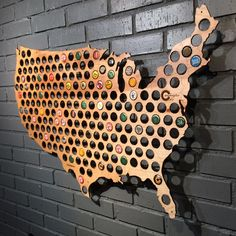 Collect & Display Your Bottle Caps With The Beer Cap Map. This is the Beer Cap Map, a wooden map made in the shape of the good ole U S of A. It comes with a bunch of holes for you to display bottle caps from the country's best breweries.