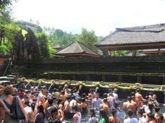Balinese bathe at the holy spring Tirta Empul during Saraswati festival in Tampak Siring Village in Bali, Indonesia.