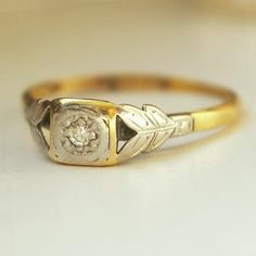 The interplay between the gold and platinum. | 40 Vintage Wedding Ring Details That Are Utterly To Die For