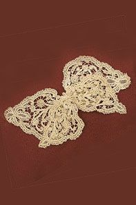 Bobbin lace bow, c. 1890. Features two layers of handmade lace.