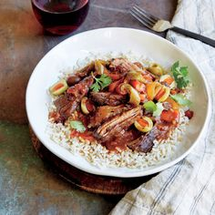 Slow Cooker Ropa Vieja | MyRecipes.com You'll be wowed by the way lean flank steak transforms into tender, succulent shreds as it slowly simmers in the aromatic sauce. Served over rice (preferably brown), this homey Cuban dish makes for an exceptionally hearty and wholesome weeknight meal.