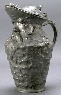 "Art Nouveau NEPTUNE Pewter Tankard, signed ""George Coudras"", body molded as waves with fish, Neptune mask below pouring lip, Height 11.5 inches"