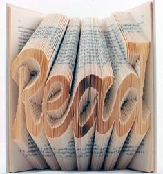 Book of Art is a series of books whose pages have been folded in such a way as to create a series of 3D words. At first glance, the careful, intricate folds appear laser cut, but at closer inspection it is apparent that the artist has, in fact, folded and manually cut individual pages to beautiful effect. This is amazing!!!