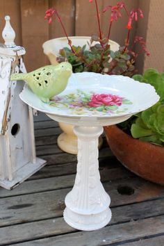 DIY Cottage Chic Birdbaths...use thrift store saucers or plates and a vase.  OR buy it from QueenRoseDesigns on Etsy, $30.00