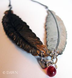 Silver feather necklace with a tiny garnet bead drop #DIY #handmade #gothic  joyas / bijoux / korut / schmuck / jewelry