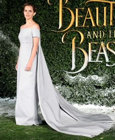 Emma Watson wears an off-the-shoulder Emilia Wickstead gown with a dramatic long cape train to the UK launch of Beauty and the Beast.