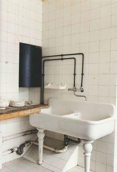 Maison de Verre. Bath.  I love the vanity sink style.  mantis ?
