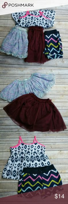Bundle of Girls Size 5/6 Spring Summer Wear Bundle of girls summer clothing items sized 5/6. Pre loved with lots of life left. Includes: Secret Life of Pets Skirt Sz 5 Maroon team spirit skirt sz 5/6 Faded Glory Chevron Print shorts size 6 Arizona Jeans navy,white and hot pink strappy open back top size 5/6 All great condition. #ravenkittyminis #ravenkittystyle #bundle #girls #summer #lot #size5 #size6 #skirts #girly #twirlskirt Bottoms Skirts