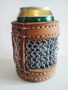 """This """"beer armor"""" was created by Canadian artist Doug Fungus. It's a lovely chainmail holder for your beer can."""