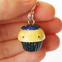This Kawaii Galaxy Cupcake charm is the perfect accessory to add a touch of cuteness to your life!   It is made out of strong oven bake polymer clay. The eyepin (finding) is secured with super glue to ensure durability.  It was glazed with a high quality gloss varnish for protection and extra...