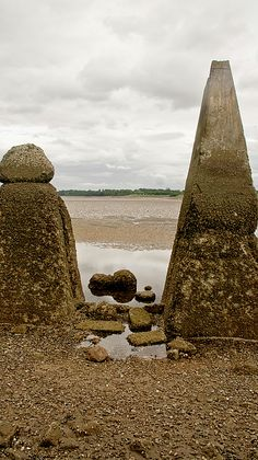 This group of pylons preserved from the wartime submarine defense are likely to walk on the sandy seabed during the low tide in the Firth of Forth on the way to the Cramond island.