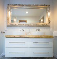 Ikea hack vanity with live edge countertop, Kohler sinks, glam mirror.