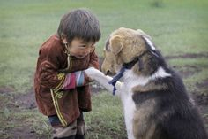 I can just imagine this beautiful child speaking to this dog. How sweet!