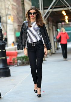 Miranda Kerr Summer street style inspiration: These days, we can't stop thinking about fringe embellishments, so consider us obsessed with the biker jacket Miranda's swung over her shoulders. She styled it smartly, with a few clean staples, so as not to distract from the focal point. Try adding a striped long sleeve tee, classic black heels, a black belt and oversized sunglasses to capture Miranda's effortless daytime style
