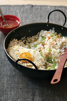 Filipino Garlic Fried Rice with Vinegar Sauce (Sinangag). This garlicky rice is a popular breakfast dish in the Philippines and is delicious served with fried eggs and a drizzle of vinegar sauce. Best of all it uses cold leftover rice. ♥ Saveur