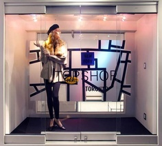 This Topshop window is simple yet it shows that whole lining pattern. The realistic mannequin is showing a very classical trend, the whole beret hat will also come back and it looks like a really cute fall outfit.