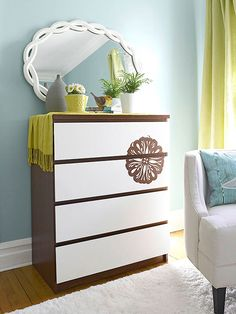 This cheap brown dresser didn't grab attention until a die cut and white paint rolled over the drawers brought it to life. Use stencil adhesive to secure a crafts store die-cut mask, cutting it to jump from one drawer to another. Roll primer and two coats of white semigloss paint over the drawers; let dry between coats. Peel away to the die-cut mask, revealing the unpainted design beneath