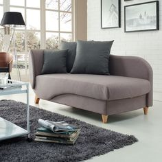 This highly stylish sofa bed combines looks, function and highest quality materials. With its double cushion design and wooden legs, it will upgrade the look of your space. It even folds to become a bed for your friends or family.