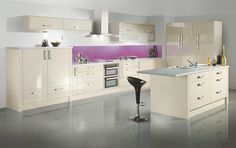 Cut Price Kitchens Sand Gloss Kitchen. An addition to the modern door portfolio in a light, subtle colour. Matching panels to create the finishing touches. Curved and bifold units and double drawers provide some fashionable storage possibilities. Comprising of 18mm thick carcases, soft-close hinges and benefits from 330mm deep wall cabinets. www.cutpricekitchens.co.uk. Kitchen Units, Kitchen Cabinets, Wall Cabinets, High Gloss Kitchen, Modern Door, Inspired Homes, Drawers, The Unit, House Design