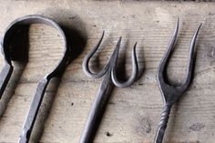 Forged devil's tail three pronged fork.
