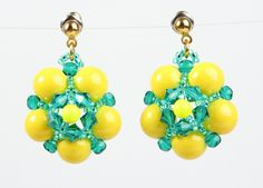 """Yellow and Emerald Flower Earrings. $25.00, via Etsy.Chunky bright yellow round balls segmented by emerald seed beads and Swarovski bicone crystals. Swarovski glass pearl in the middle. Yellow studs. Handmade in the USA.  Length: 1 1/8"""".  Color combinations are available upon request."""