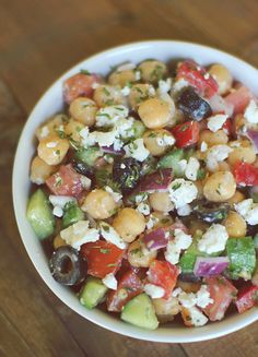 Mediterranean Chickpea Salad  For the Salad:  1(15 oz) Can garbanzo beans (aka chickpeas)1/8 cup Flat leaf parsley, chopped1/2 cup Red bell pepper, diced1/2 cup Roma tomato, diced1/8 cupcup olives, sliced2 oz Reduced fat feta cheese, crumbled1/8 cupRed onion, finely chopped....  For the Dressing:1/2 tbs Lemon juice1/2 tbs Red wine vinegar1/4 tsp Garlic, chopped1 tbs Plain low fat greek yogurt PinchSalt and pepper (or to taste) Optional:Pinch of stevia1/2 cup English cucumber, diced