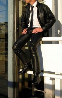 Try a smart Urban look that will turn heads day or night: Tight leather pants, jacket and white shirt (dress, uniform or military) and tie. Nice.