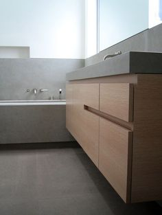 bycocoon.com #minimalist bathroom by Jensen Architects with stainless steel Vola taps