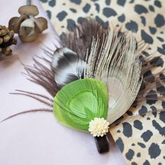 Feel natural and breezy with this lime green, beige, and mocha colored feathers with an ivory flower charm. You can place this gorgeous clip in your hair on a bright spring day! Indie made. $29
