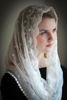 A veil in honor of Our Lady, Star of the Sea (Latin: Stella Maris) An incredibly soft and light veil. This is a lovely and soft fabric, strewn with tiny star-flowers. The delicate flowers are scattered over the entire veil, and the edge is embroidered around the face. Finished with a