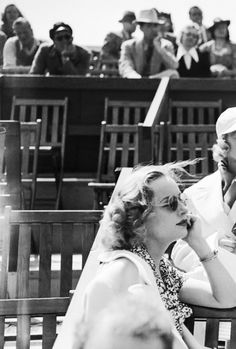 Carole Lombard watches the Beverly Hills Tennis Tournament, 1938