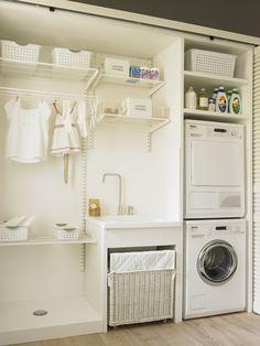 Práctico mueble de lavado y secado. Practical wasching and drying cabinet.
