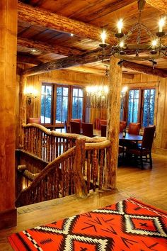 rustic staircase made from native lodge pole pine by Peace Design - Montana