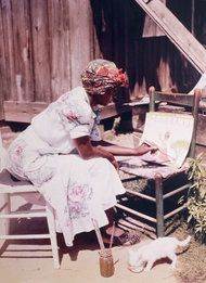 Clementine Hunter (1887-1988) was a self-taught African-American folk artist from the Cane River region in Louisiana. She was born on a plantation said to be the inspiration for Uncle Tom's Cabin and worked as a farm hand, never learning to read or write. When in her fifties, she began painting, using brushes and paints left by an artist who visited Melrose Plantation, where she lived and worked. Hunter's artwork depicted plantation life in the early 20th century, documenting a bygone era.