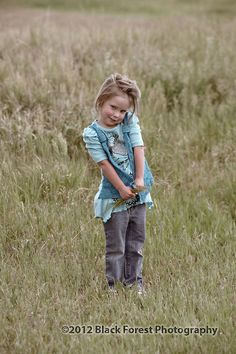 Antiqued child portrait for the country look for the true Colorado feel. She really poses! Colorado Springs kids photographer Black Forest Photography http://www.blackforestphoto.com #chldrenphotography #photography #coloradosprings  #portraits #kids