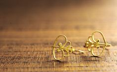 K18 pierced earrings leafy
